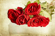 Red roses on vintage background