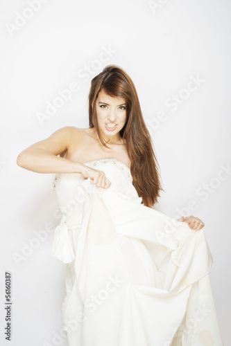 beautiful young woman ripping a wedding dress