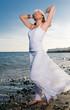 woman enjoying the sea wearing white clothes
