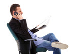 man reads newspaper phoning - economy news