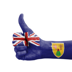 Hand with thumb up, Turks and Caicos Islands flag painted