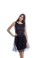 Smiling hot brunette posing in black smart dress