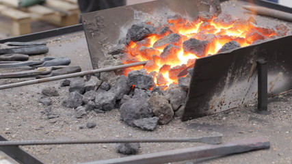 Blacksmith work. Hot coals burning.
