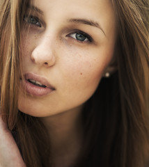 portrait of a beautiful brunette with clean face