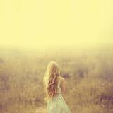 beautiful young blond woman enjoying the fabulous nature - 56166745