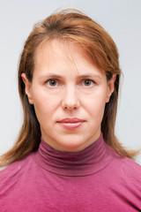 Closeup studio face portrait of young Caucasian woman