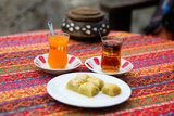 Orange and apple Turkish tea served with baklawa
