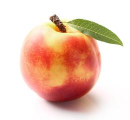 One ripe nectarine with leaf