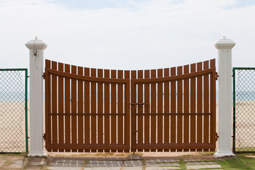 wooden gate with sea background