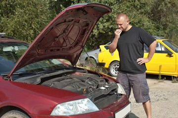 man repairing the car, helplessness, failure cars