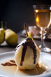 Delicious pear dessert with chocolate and amaretto liqueur