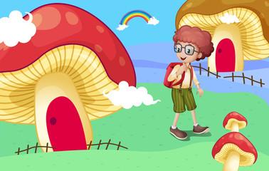 A boy near the giant mushroom houses