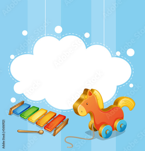 An empty cloud template with a toy horse and a xylophone