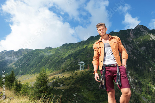 casual man with a hand in pocket, in the mountains