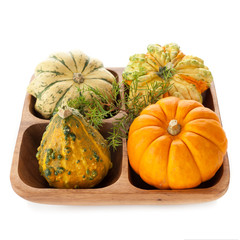 Wooden bowl with pumpkins