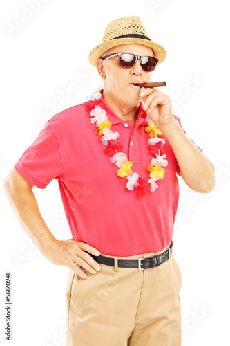 Mature gentleman with lei smoking a cigar and looking at camera