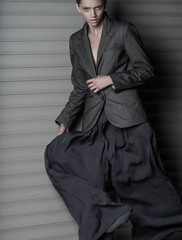 Fashion women dinamic move in suit on gray background
