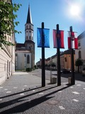 Church tower and flags in Levoca