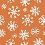 White snowflakes on brown background