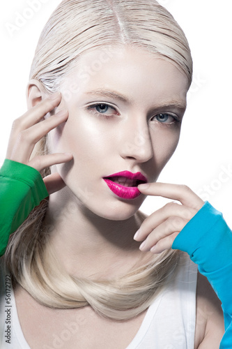 fashion model touches face mouth look at camera
