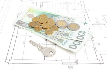 Money and silver key lying on the housing plan