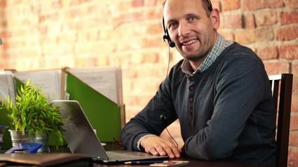Portrait of friendly helpdesk operator