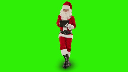 Santa Claus taking notes and sitting, Green Screen