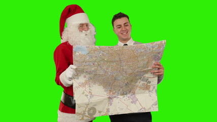 Santa Claus with a Young Businessman reading a map, Green Screen