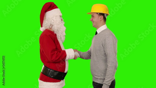 Santa Claus and Young Architect shaking hands, Green Screen