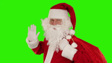 Santa Claus carrying his bag, sends a kiss, Green Screen