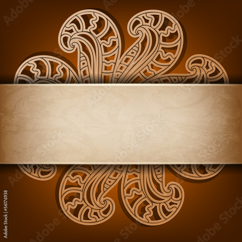 Abstract openwork flower on a brown background