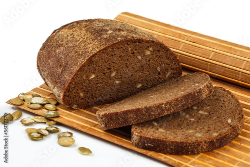 rye bread with pumpkin seeds on the mat