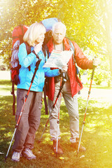 Old people with rucksacks