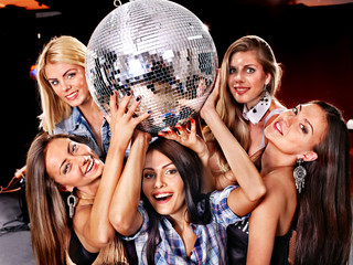 Woman on disco in night club.