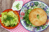 Bagel with cream cheese, cucumber and watercress with salad