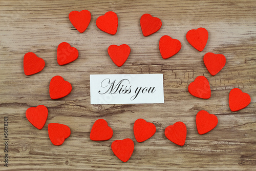 Miss you card with little red wooden hearts