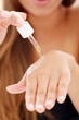 Woman applying cosmetics on her hands