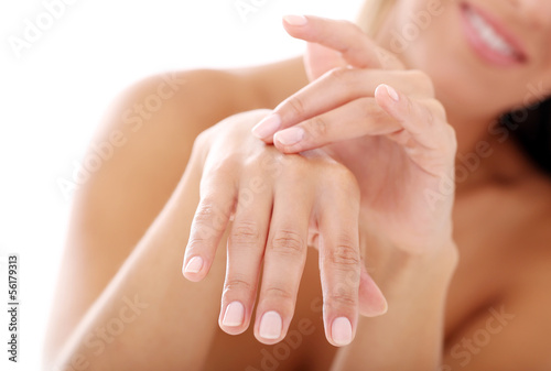Woman applying cosmetics on her hands