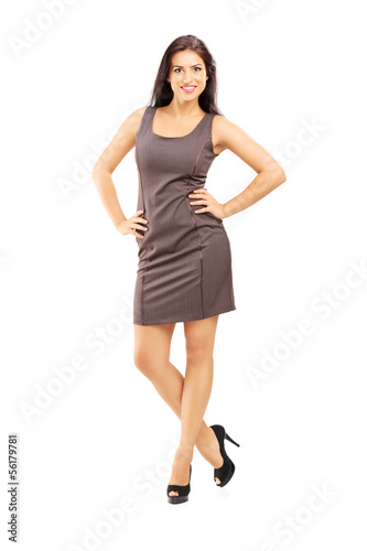 Full length portrait of a smiling fashionable woman in dress