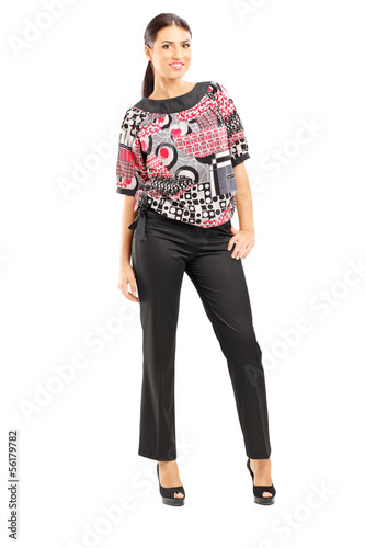 Full length portrait of a smiling fashionable woman posing