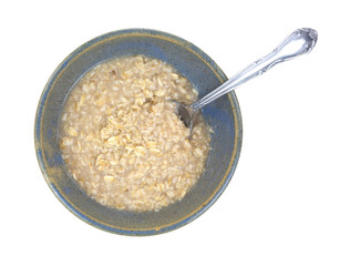 Oatmeal cereal in bowl with spoon