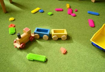 Spielzeug auf Teppich