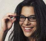 Smiling pretty woman wearing glasses