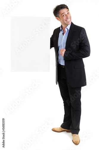 Smiling businessman holding a blank white sign