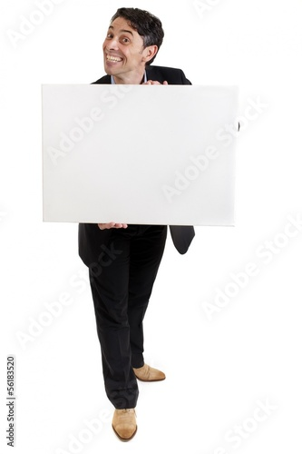 Businessman with a cheesy grin holding a sign