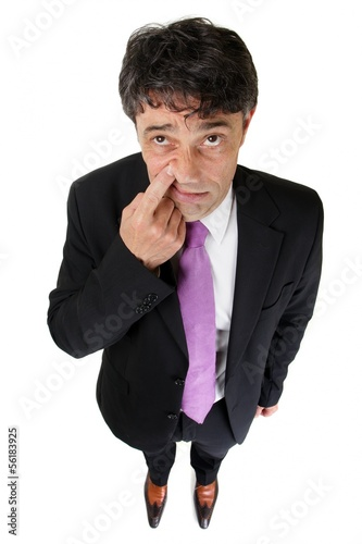 Businessman raising a finger and tapping his nose