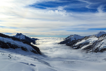 Mountain peaks above the clouds in the Swiss Jungfrau region