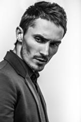 yong fashion man portrait on gray background