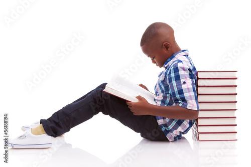 African American school boy reading a book - Black people - 56188194