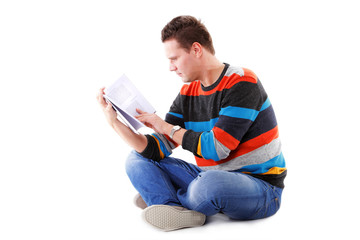 male student reading a book isolated